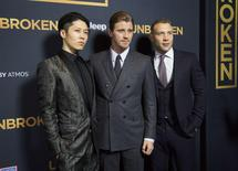 """Cast members (L to R) Takamasa Ishihara, Garrett Hedlund and Jai Courtney pose at the premiere of """"Unbroken"""" at Dolby theatre in Hollywood, California December 15, 2014. REUTERS/Mario Anzuoni"""