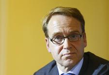 Jens Weidmann, chief of Germany's Bundesbank, listens during a news conference after talks with Anne Le Lorier, first deputy governor of the Banque de France, German Finance Minister Wolfgang Schaeuble, French Finance Minister Michel Sapin, French Economy Minister Emmanuel Macron and German Economy Minister Sigmar Gabriel in Berlin, December 2, 2014. REUTERS/Hannibal Hanschke