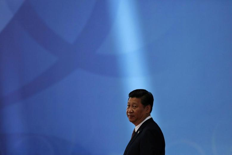 Chinese President Xi Jinping waits for leaders to arrive before the opening ceremony in the Expo Center at the fourth Conference on Interaction and Confidence Building Measures in Asia (CICA) summit in Shanghai, in this May 21, 2014 file photo.   REUTERS/Aly Song/Files