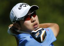 South Korea's Bae Sang-moon hits his tee shot on the seventh hole during the second round of the Masters golf tournament at the Augusta National Golf Club in Augusta, Georgia April 11, 2014. REUTERS/Mike Blake
