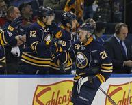 Buffalo Sabres center Zemgus Girgensons (28) celebrates his goal against the Calgary Flames during the third period at First Niagara Center. Sabres beat the Flames 4-3. Mandatory Credit: Kevin Hoffman-USA TODAY Sports - RTR4HPB1