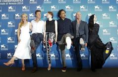 """Director Alejandro Inarritu (3rd R) poses with actors Amy Ryan (L), Edward Norton (2nd L), Emma Stone (3rd L), Michael Keaton (2nd R) and Andrea Riseborough (R) during the photo call for the movie """"Birdman or (The unexpected virtue of ignorance)"""" at the 71st Venice Film Festival August 27, 2014. REUTERS/Tony Gentile"""