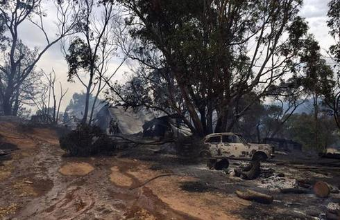 Australian firefighters battle to contain worst wildfires in 30 years