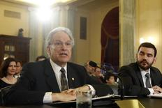 Mark Rosekind (L) testifies before a Senate Commerce Science and Transportation Committee hearing on his nomination to be administrator of the National Highway Traffic Safety Administration (NHTSA) on Capitol Hill in Washington December 3, 2014. REUTERS/Yuri Gripas