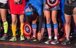 Runners in super hero outfits prepare at the start of the Avengers Super Heroes Half Marathon in and around the Disney Parks in Anaheim, California, in this file photo from November 16, 2014. REUTERS/Eugene Garcia