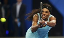 Serena Williams of the U.S. plays a backhand shot to Lucie Safarova of Czech Republic during their women's singles tennis match at the 2015 Hopman Cup in Perth, Australia, January 8, 2015. REUTERS/Stringer