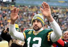Jan 11, 2015; Green Bay, WI, USA; Green Bay Packers quarterback Aaron Rodgers (12) waves to the crowd after the 2014 NFC Divisional playoff football game against the Dallas Cowboys at Lambeau Field. Andrew Weber-USA TODAY Sports