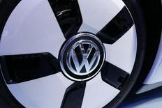 The VolksWagen logo is seen on their XL 1 car during the media day at the Paris Mondial de l'Automobile, October 3, 2014. REUTERS/Jacky Naegelen