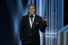 George Clooney accepts the Cecile B. DeMille Award at the 72nd Golden Globe Awards in Beverly Hills.  REUTERS/Paul Drinkwater/NBC
