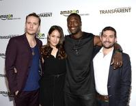 "Actors (from L) Sam Littlefield, Jaina Lee Ortiz, Aldis Hodge and Joe Lewis (R), Head of Original Programming at Amazon Studios, pose during Amazon's premiere screening of the TV series ""Transparent"" at the Ace Hotel in downtown Los Angeles, California, September 15, 2014. REUTERS/Kevork Djansezian  (UNITED STATES - Tags: ENTERTAINMENT) - RTR46DQA"