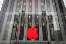 The Apple logo is illuminated in red at the Apple Store on 5th Avenue to mark World AIDS Day, in the Manhattan borough of New York December 1, 2014.  REUTERS/Carlo Allegri/Files