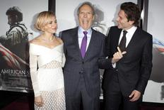 "Actress Sienna Miller (L), director Clint Eastwood and actor Bradley Cooper arrive for the premiere of the film ""American Sniper"" in New York, in this file photo taken December 15, 2014.  REUTERS/Carlo Allegri/Files"