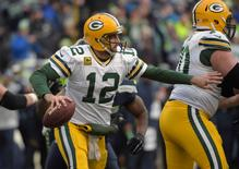 Green Bay Packers quarterback Aaron Rodgers (12) looks to throw the ball against the Seattle Seahawks during the fourth quarter in the NFC Championship Game at CenturyLink Field. Mandatory Credit: Kirby Lee-USA TODAY Sports