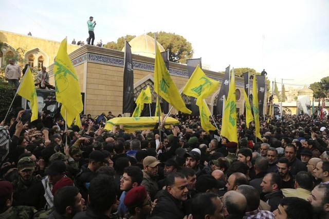 Lebanon's Hezbollah members and supporters carry the coffin of Jihad Moughniyah during his funeral in Beirut's suburbs January 19, 2015.  REUTERS/Aziz Taher