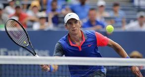 Андрей Кузнецов в матче U.S. Open против британца Энди Маррея. Нью-Йорк, 30 августа 2014 года. Российский теннисист Андрей Кузнецов вышел во второй круг Открытого чемпионата Австралии. REUTERS/Eduardo Munoz