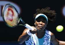 Venus Williams of the U.S. stretches to hit a shot against Lauren Davis of the U.S. during their women's singles second round match at the Australian Open 2015 tennis tournament in Melbourne January 22, 2015. REUTERS/Athit Perawongmetha