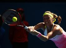 Petra Kvitova of Czech Republic hits a return against Mona Barthel of Germany during their women's singles second round match at the Australian Open 2015 tennis tournament in Melbourne January 22, 2015. REUTERS/Thomas Peter