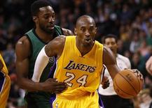 Dec 5, 2014; Boston, MA, USA; Los Angeles Lakers guard Kobe Bryant (24) drives to the hoop against Boston Celtics forward Jeff Green (back) during the second half at TD Garden. Mandatory Credit: Mark L. Baer-USA TODAY Sports - RTR4GX0I
