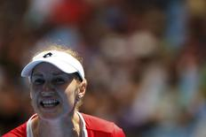 Ekaterina Makarova of Russia reacts after defeating Karolina Pliskova of the Czech Republic during their women's singles third round match at the Australian Open 2015 tennis tournament in Melbourne January 23, 2015. REUTERS/Athit Perawongmetha