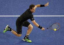Andy Murray of Britain stretches to hit a return to Grigor Dimitrov of Bulgaria during their men's singles fourth round match at the Australian Open 2015 tennis tournament in Melbourne January 25, 2015. REUTERS/Carlos Barria
