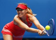 Maria Sharapova of Russia stretches to hit a return to Eugenie Bouchard of Canada during their women's singles quarter-final match at the Australian Open 2015 tennis tournament in Melbourne January 27, 2015. REUTERS/Thomas Peter
