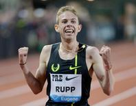May 30, 2014; Eugene, OR, USA; Galen Rupp (USA) celebrates after winning the 10,000m in an American record 26:44.36 in the 40th Prefontaine Classic at Hayward Field. Mandatory Credit: Kirby Lee-USA TODAY Sports