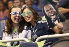 Jan 27, 2015; Phoenix, AZ, USA; Seattle Seahawks fans Meredith Grissom from Orlando, Florida and Allie Pfeiffer of Stockton, California during media day for Super Bowl XLIX at US Airways Center. Mandatory Credit: Rob Schumacher-Arizona Republic via USA TODAY Sports