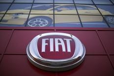 Fiat Chrysler a atteint ses objectifs 2014 grâce à ses performances en Amérique du Nord et à une amélioration en Europe qui ont compensé une faiblesse persistante en Amérique latine. /Photo prise le 13 octobre 2014/REUTERS/Mario Anzuoni