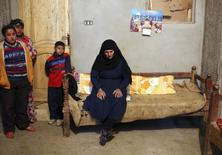 Aziza Younan, mother of Abanob Ayyad, one of 27 Egyptian Coptic Christian workers kidnapped in the Libyan city of Sirte, sits on a bed at the family's house in Al-Our village, in Minya governorate, south of Cairo, January 21, 2015.     REUTERS/Asmaa Waguih
