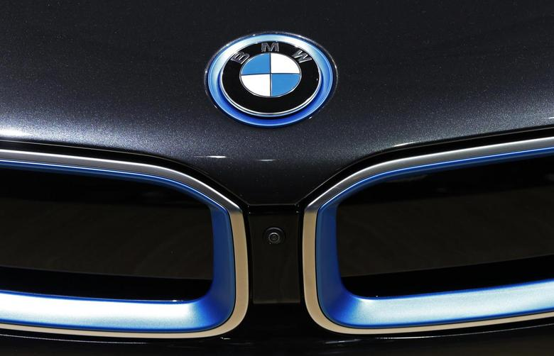 A BMW logo is seen on a car at the Brussels International Auto Show January 22, 2015.  REUTERS/Yves Herman