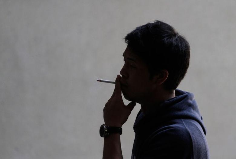 A man smokes a cigarette in Los Angeles, California, May 31, 2012. REUTERS/Jonathan Alcorn