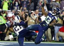 Feb 1, 2015; Glendale, AZ, USA; New England Patriots strong safety Malcolm Butler (21) intercepts a pass intended for Seattle Seahawks wide receiver Ricardo Lockette (83) in the fourth quarter in Super Bowl XLIX at University of Phoenix Stadium.  Mark J. Rebilas-USA TODAY Sports