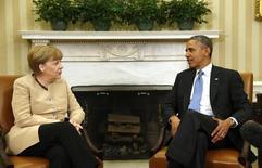 Канцлер Германии Ангела Меркель и президент США Барак Обама на встрече в Белом доме. 2 мая 2014 года. REUTERS/Kevin Lamarque
