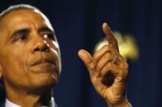 Президент США Барак Обама во время выступления на конференции в Пенсильвании. 29 января 2015 года. Президент США Барак Обама в понедельник предложил бюджет на 2016 бюджетный год размером $3,99 триллиона, который рискует стать поводом для ожесточенных споров с республиканцами по поводу программ поддержки среднего класса, финансируемых посредством повышения налогов на доходы корпораций и богатых граждан. REUTERS/Larry Downing