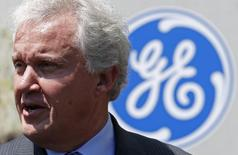 General Electric Chairman and CEO Jeffrey Immelt chats attends a visit at the gas turbines production unit of the GE plant in Belfort, June 24, 2014.  REUTERS/Vincent Kessler