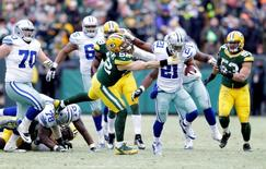 Dallas Cowboys running back Joseph Randle (21) stiff arms Green Bay Packers outside linebacker Clay Matthews (52) in the 2014 NFC Divisional playoff football game at Lambeau Field. Mandatory Credit: Jeff Hanisch-USA TODAY Sports