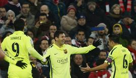 Barcelona's (L-R) Luis Suarez, Lionel Messi and Xavi Hernandez celebrate a goal by Messi during their Spanish first division soccer match against Athletic Bilbao at San Mames stadium in Bilbao February 8, 2015. REUTERS/Vincent West