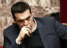 Greek Prime Minister Alexis Tsipras listens to the speech of Greek Finance Minister Yanis Varoufakis (not pictured) before a vote of confidence at the parliament in Athens February 10, 2015. REUTERS/Alkis Konstantinidis