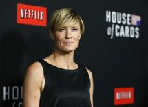 """Cast member Robin Wright poses at the premiere for the second season of the television series """"House of Cards"""" at the Directors Guild of America in Los Angeles, California February 13, 2014. Season 2 premieres on Netflix on February 14.   REUTERS/Mario Anzuoni"""