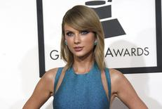 Pop singer Taylor Swift arrives at the 57th annual Grammy Awards in Los Angeles, California February 8, 2015.  REUTERS/Mario Anzuoni