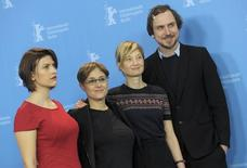 Director Laura Bispuri and actors Flonja Kodheli (L) Alba Rohrwacher (2nd R) and Lars Eidinger (R) pose during a photocall to promote the movie 'Sworn Virgin' in competition at the 65th Berlinale International Film Festival in Berlin February 12, 2015.                  REUTERS/Stefanie Loos