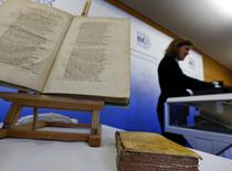 One of over 500 ancient books, with original editions of Galileo Galilei and Nicolaus Copernicus among them, is presented by German police during a news conference at the Munich Federal state police headquarters, February 13, 2015.    REUTERS/Michael Dalder