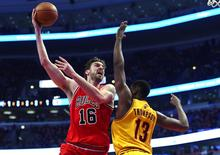 Feb 12, 2015; Chicago, IL, USA; Chicago Bulls forward Pau Gasol (16) shoots the ball against Cleveland Cavaliers center Tristan Thompson (13) during the first quarter at the United Center. Mandatory Credit: Mike DiNovo-USA TODAY Sports