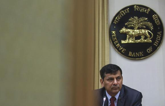 The Reserve Bank of India (RBI) Governor Raghuram Rajan listens to a question during a news conference, after the bi-monthly monetary policy review, in Mumbai, Febraury 3, 2015. REUTERS/Danish Siddiqui
