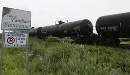 A freight car for crude oil sits outside the town of Farnham, Quebec, July 10, 2013. REUTERS/Christinne Muschi