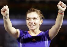 Simona Halep of Romania celebrates after winning the singles tennis final match at the WTA Dubai Tennis Championships February 21, 2015. REUTERS/Ahmed Jadallah
