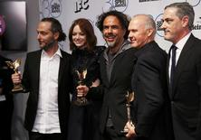 Emmanuel Lubezki (L) poses backstage with his Best Ciinematography award along with (L-R) actress Emma Stone, producer Alejandro Gonzalez Inarritu with his Best Feature award, actor Michael Keaton with his Best Male Lead award and producer John Lesher during the 2015 Film Independent Spirit Awards in Santa Monica, California February 21, 2015. REUTERS/Danny Moloshok