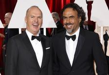 """Michael Keaton (L), nominated for Best Actor for the film """"Birdman"""" and Alejandro Gonzalez Inarritu, nominated for Best Director for the same film, arrive at the 87th Academy Awards in Hollywood, California February 22, 2015.    REUTERS/Lucas Jackson"""
