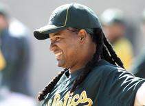 Former Oakland Athletics' slugger Manny Ramirez of the Dominican Republic warms up as he prepares to take batting practice before the start of their first spring training game at Phoenix Municipal stadium in Phoenix, Arizona, in this file photo taken on March 2, 2012. REUTERS/Darryl Webb