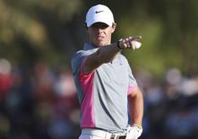 Rory McIlroy of Northern Ireland points on the 18th hole during the Dubai Desert Classic January 31, 2015. REUTERS/Stringer